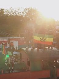 Jahman music video screen shot from Herbs, musicians dancing on bus in Jamaica