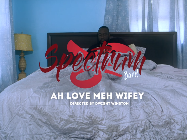 Spectrum Band video opening screen for I Love Meh Wifey, man in bed